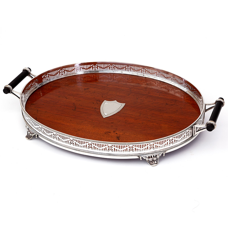 Super quality polished oak and silver plate gallery tray with pierced frieze, ebony handles and vacant shield cartouche. c.1890.