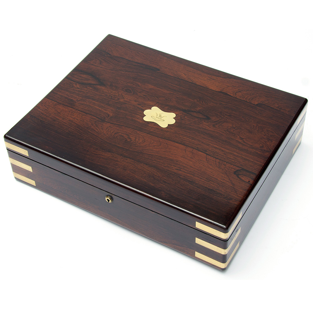 Antique brass mounted rosewood box with brass crest. Circa 1870