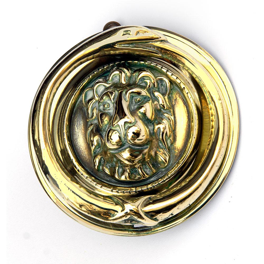 Polished cast brass antique lions head door knocker with serpent clapper. (c.1880).