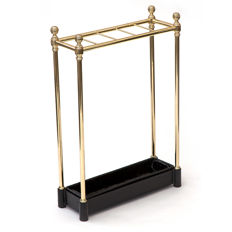 Antique brass and cast iron five section stick stand with removable drip tray. c.1900.