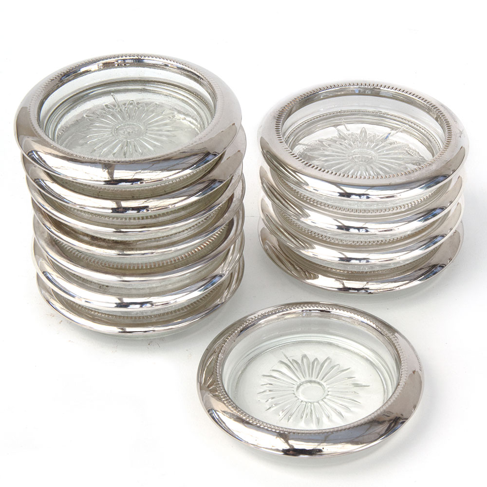 Set of 12 mid 20th Century cut glass coasters with silver plate rims.