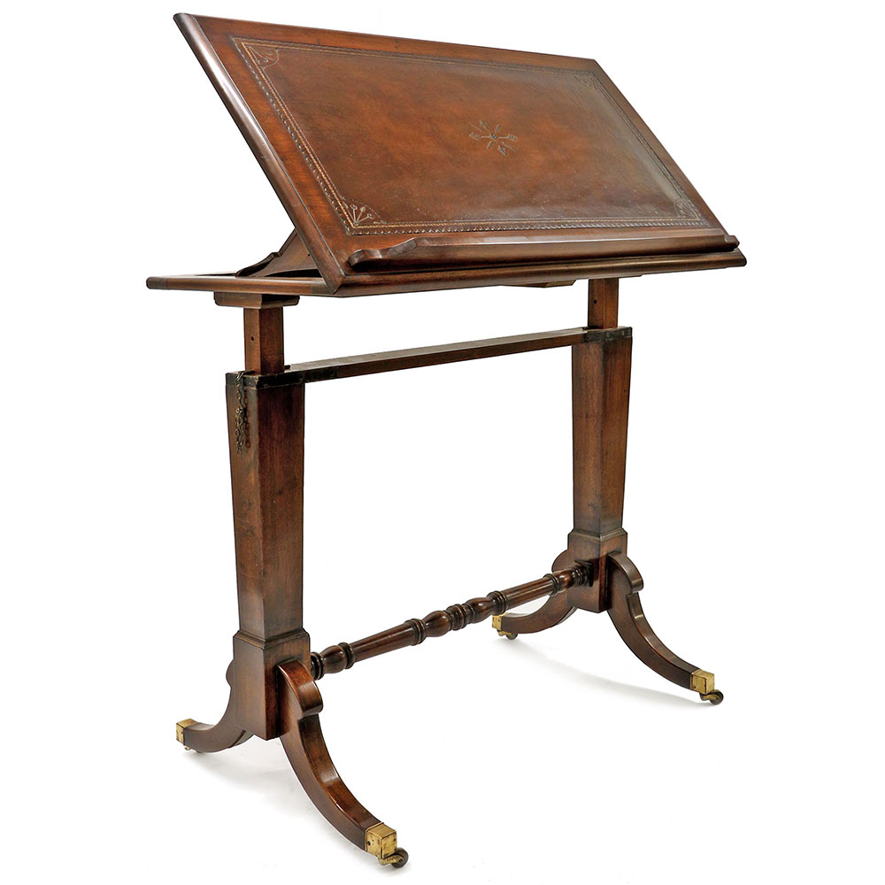 Antique mahogany fully adjustable draftsmans table with tooled inset leather top. Circa 1900.