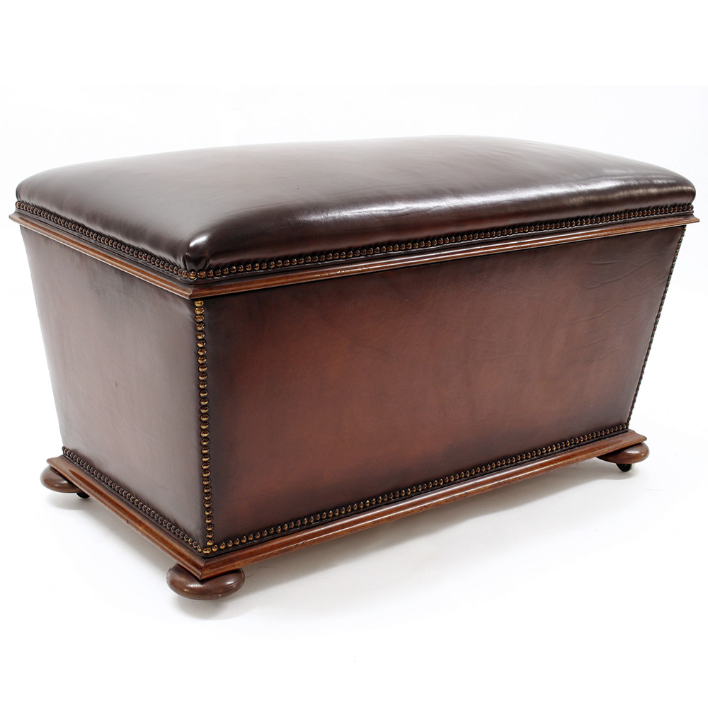 Antique mahogany framed brown leather ottoman on bun feet. (c.1880)