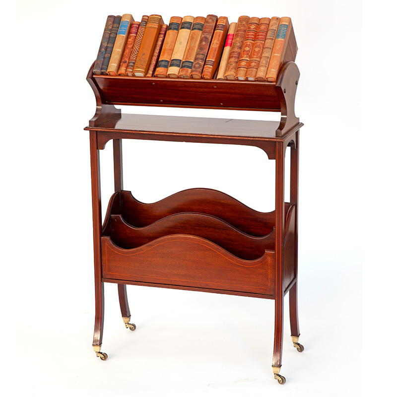 Boxwood inlaid mahogany book trough or canterbury with original brass castors (c.1900).