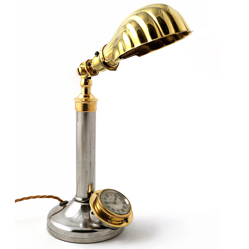 Unusual steel and brass bankers lamp incorporating clock. Circa 1920.