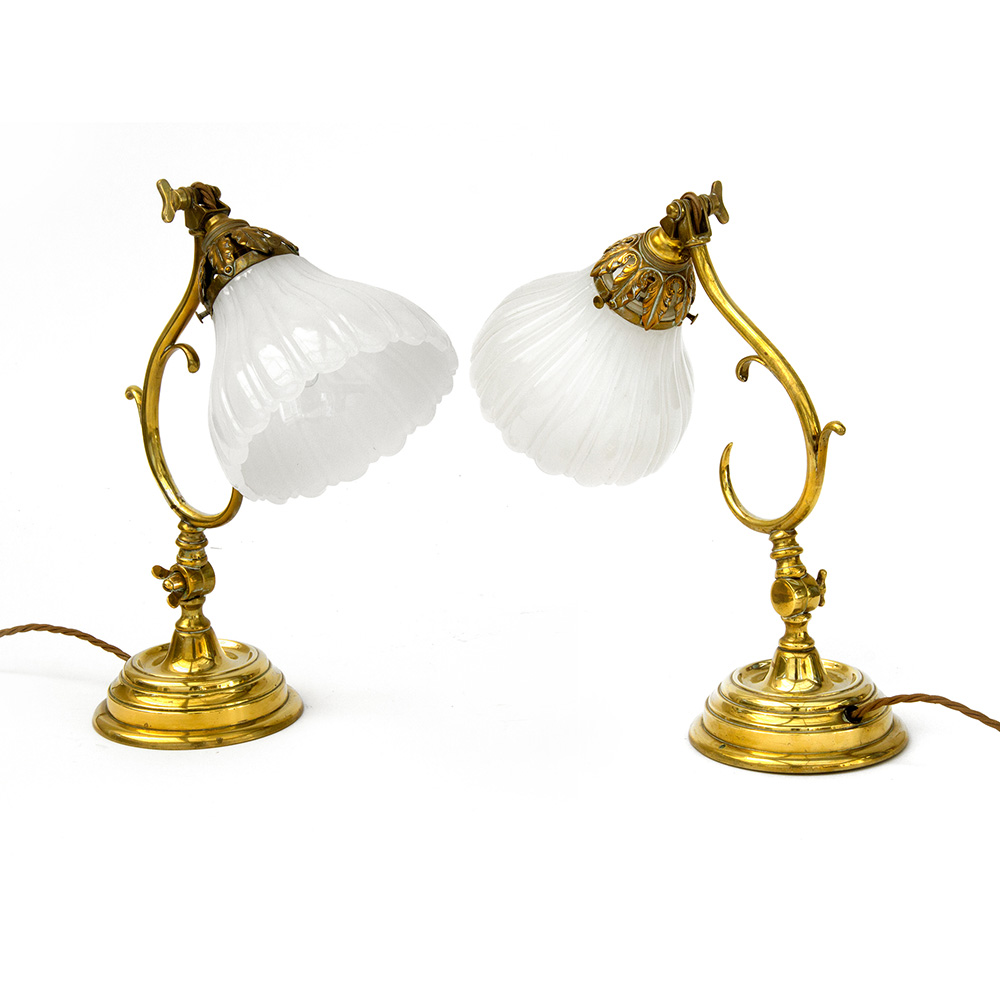 Pair of antique heavy cast brass adjustable Bankers lamps with opeline shades. Circa 1910.