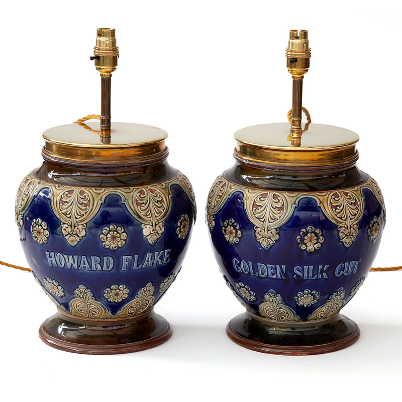 Extremely rare pair of antique Royal Doulton (stamped) tobacco jars converted into lamps. Circa 1900.