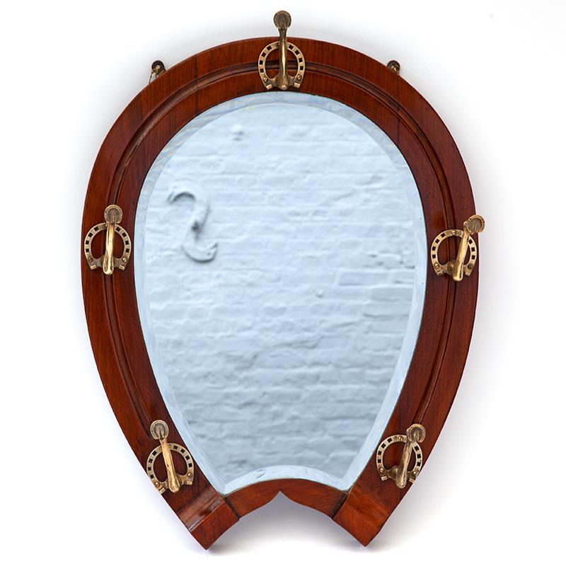 Extremely rare oak deep bevelled horseshoe mirror with cast brass fetlock and horseshoe hooks. (c.1890).