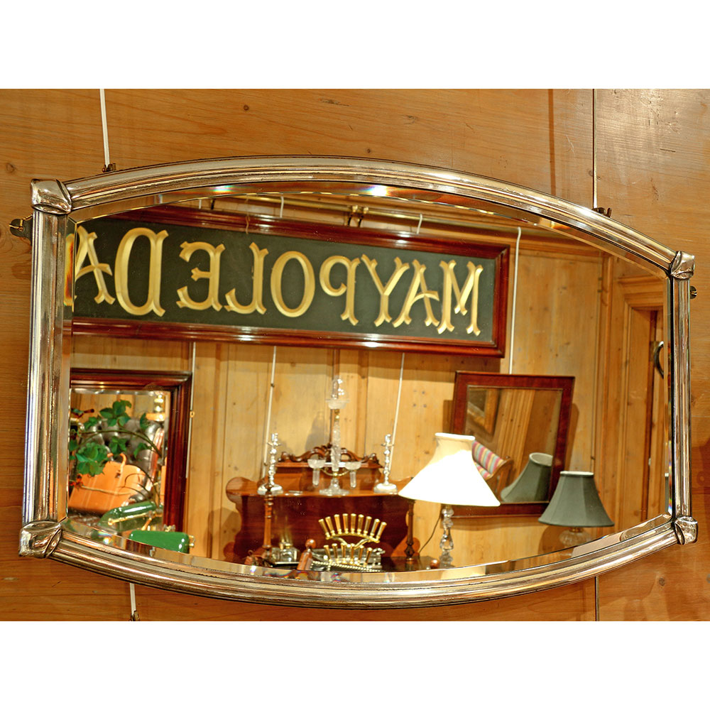 Gutsy Art Deco nickel plated mirror with original bevelled plate. Circa 1930.