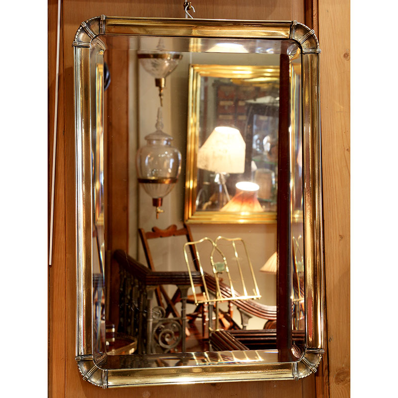 Antique French deep bevelled mirror in heavy cast brass frame with original plate. (c.1920)