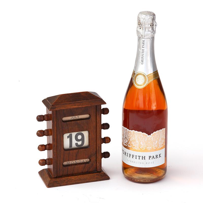 Antique gable topped mahogany perpetual calendar. (c.1900)