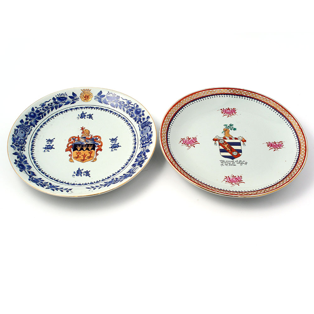 Pair of 20th century heavy glazed pottery armorial plates.