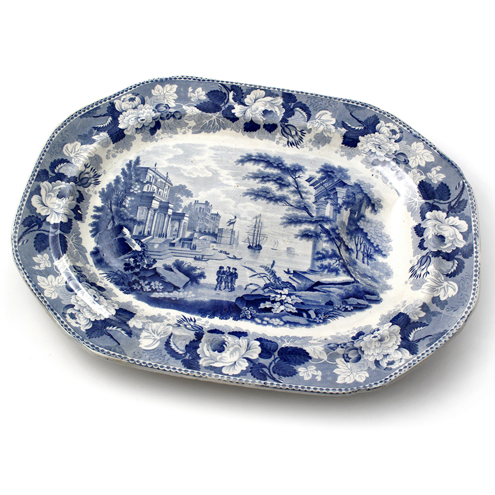 Antique blue and white glazed pottery meat plate. Circa 1840.