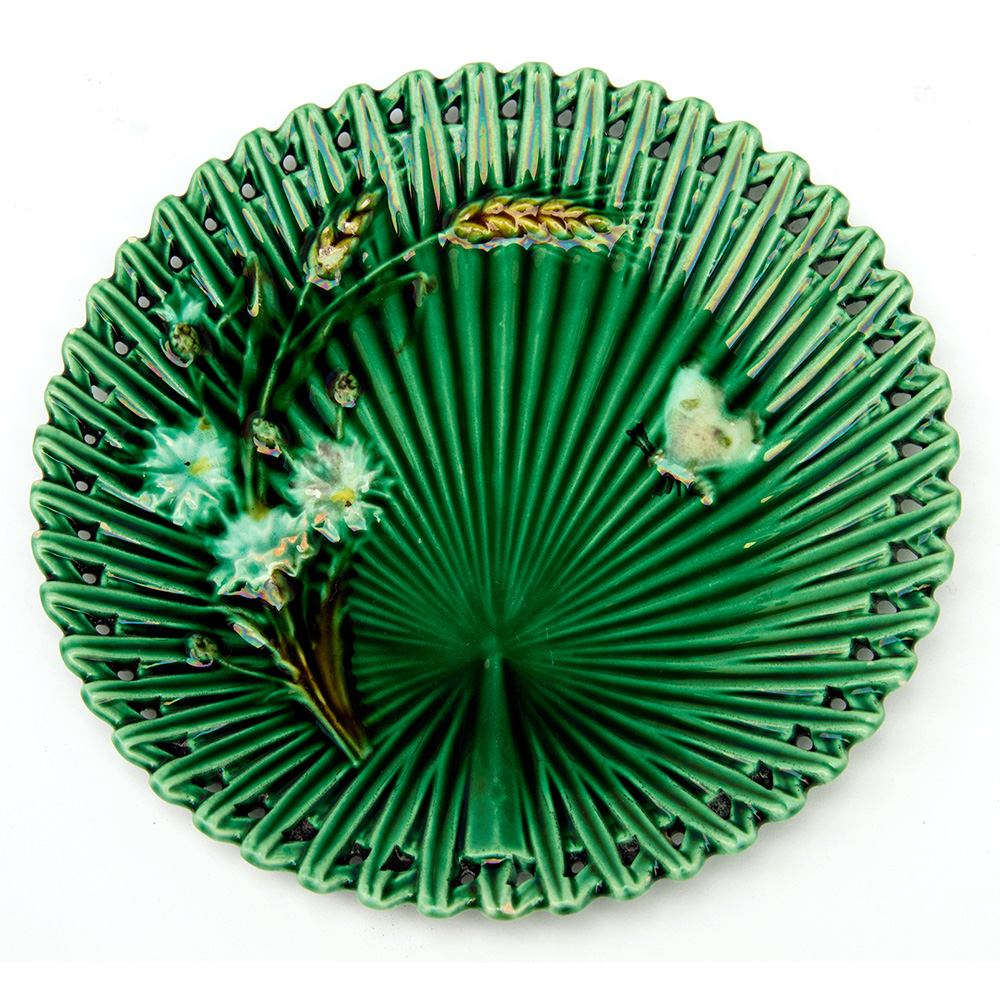 French majolica plate with pierced border and reverse stamp. Circa 1920.