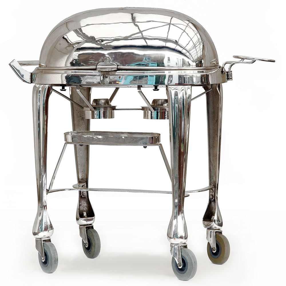 Stunning silver plate roast beef cart complete with twin burners, sauce boats, carving set tray and sprung plate holder. (c.1930)