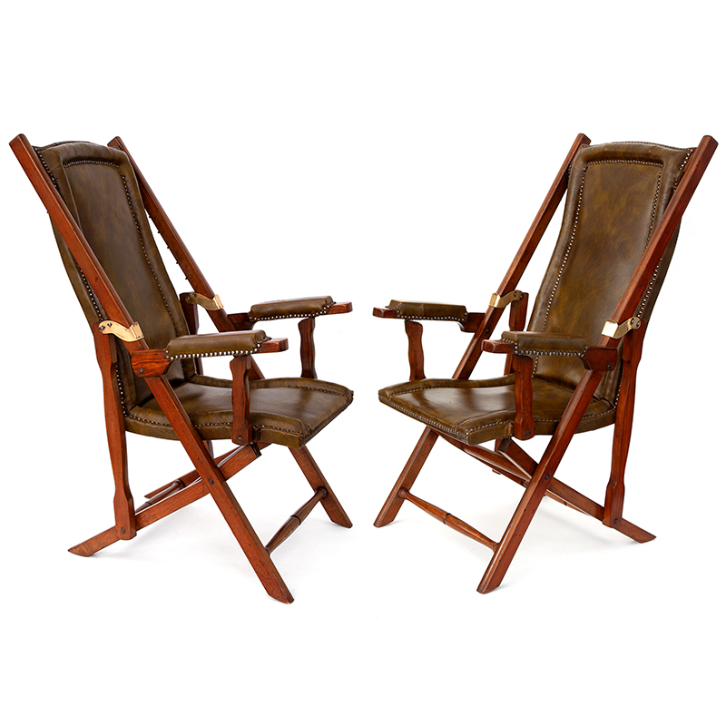 Pair of mid 20th C. teak and brass steamer chairs with original leather.
