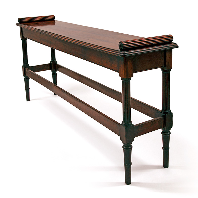 Mid 19th Century mahogany window seat or hall bench with turned and reeded legs united by stretchers.