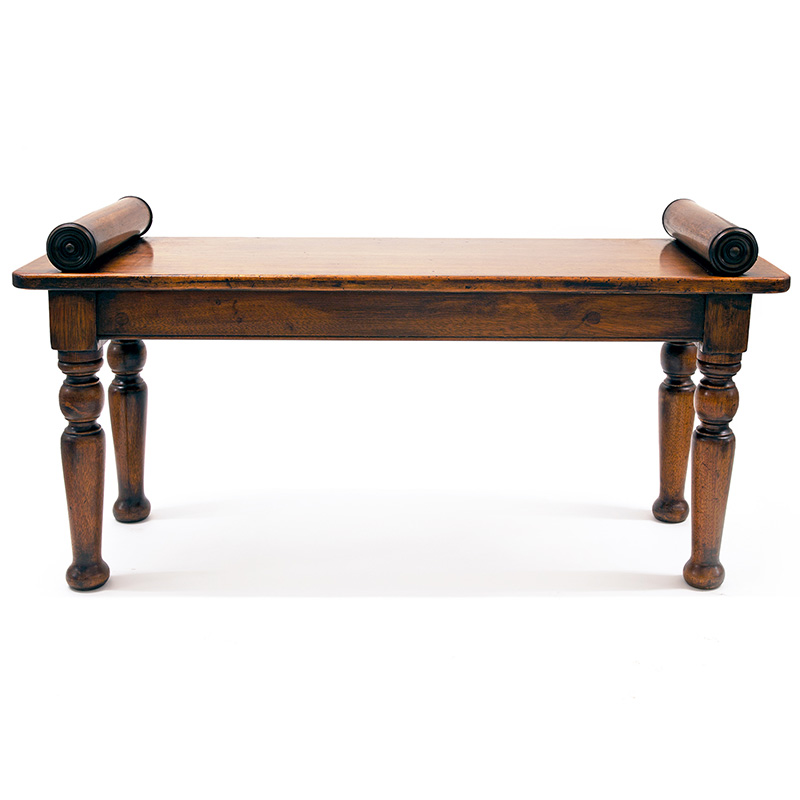 Chunky mahogany hall bench with turned legs and bolster ends. (c.1860).