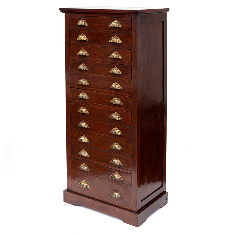 Antique flight of 12 walnut drawers with scalloped brass handles. c.1910