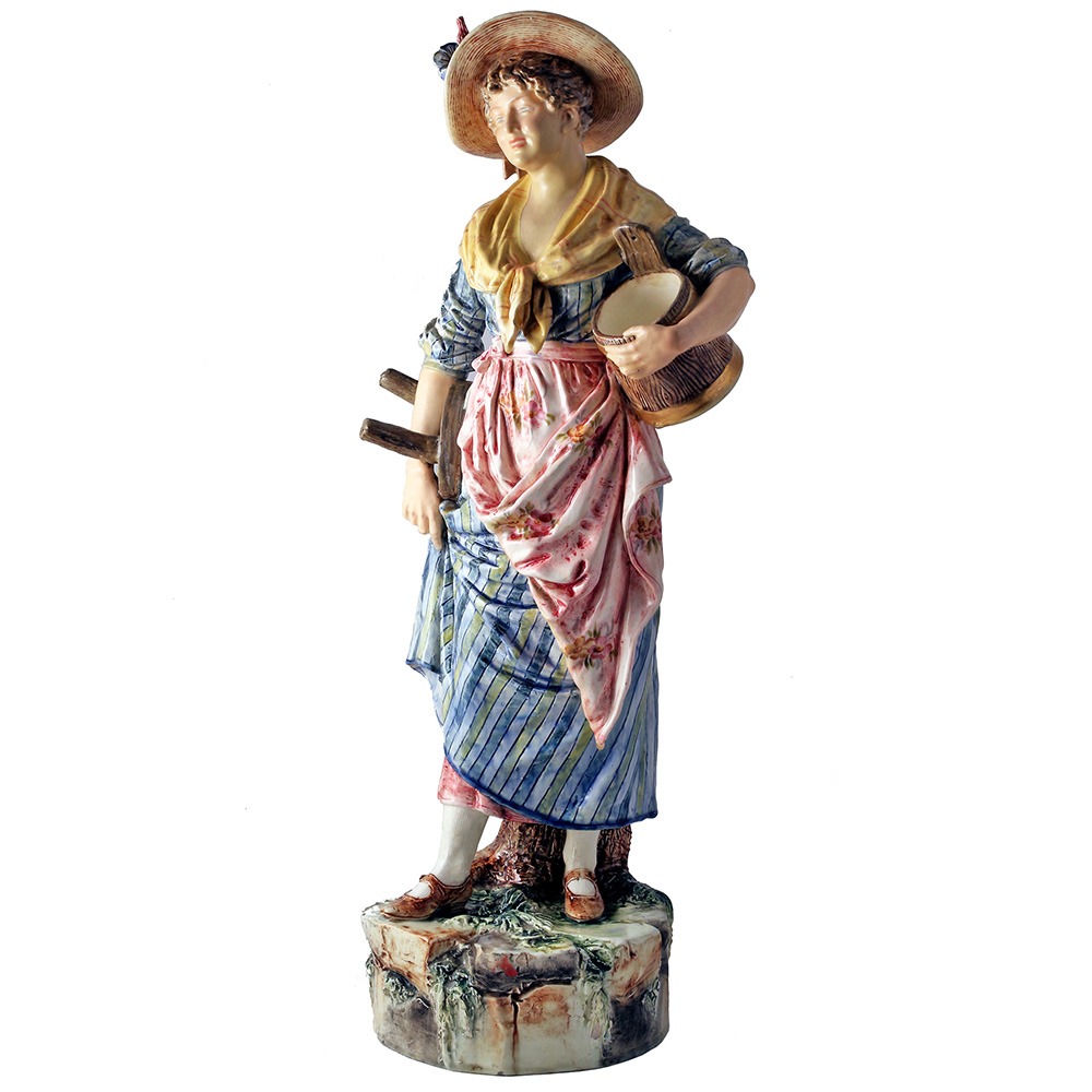 Antique dairy window display glazed pottery milk maid. Circa 1900.