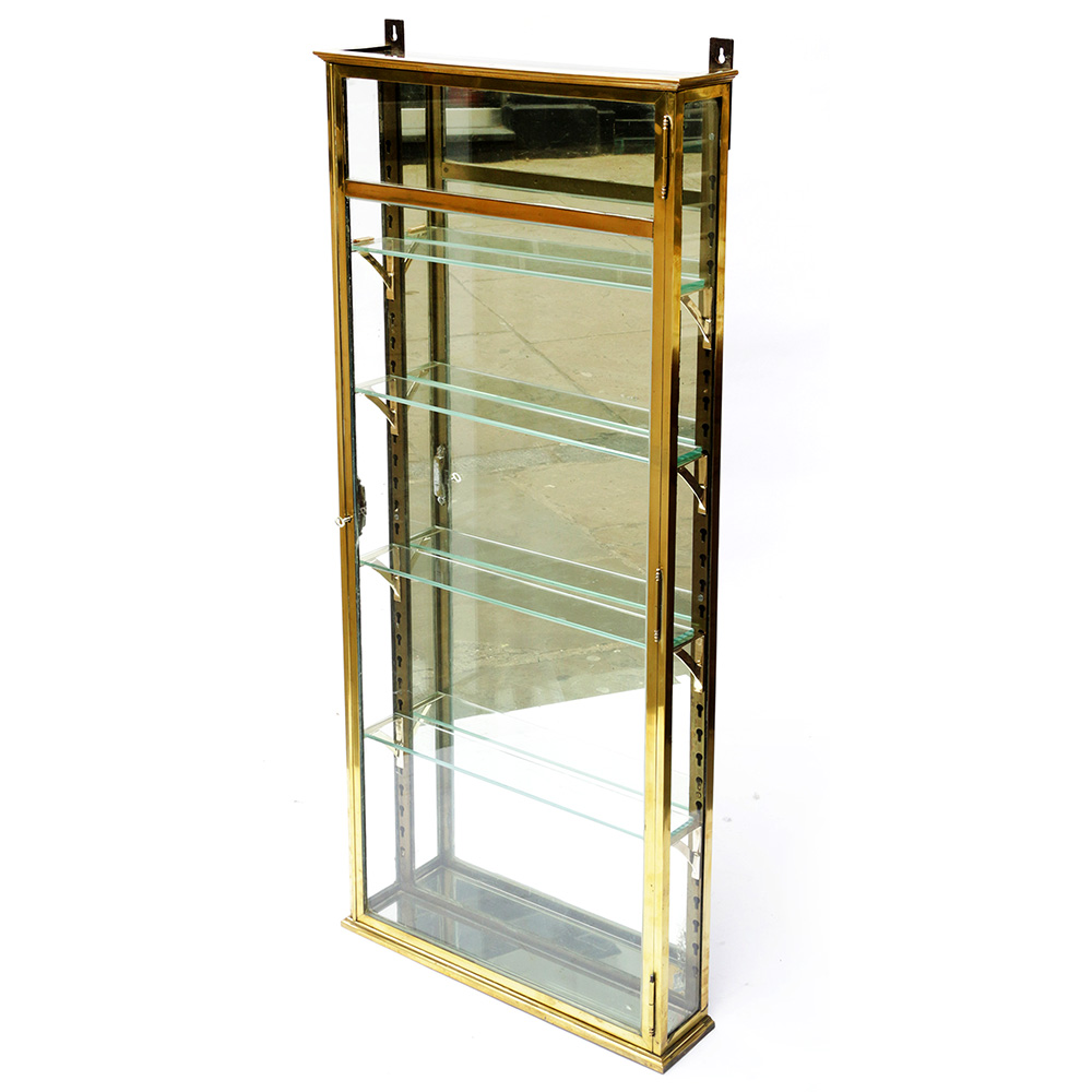 Antique French brass wall mounted display cabinet with four adjustable shelves. Circa 1890.