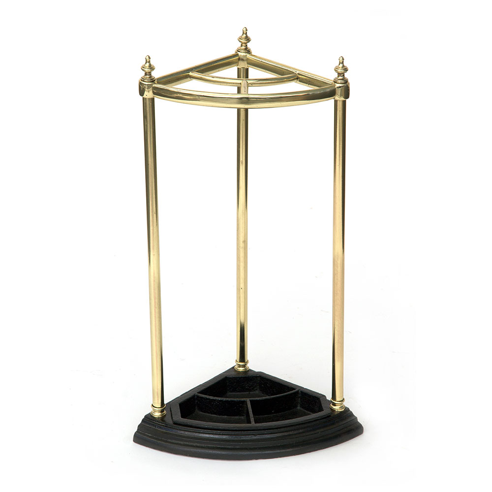 Antique small corner brass stick stand with cast iron base and removable sectioned drip tray. Circa 1890.
