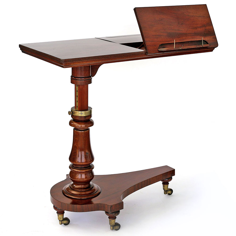 Antique flame mahogany adjustable reading table or music stand with brass fittings. Circa 1840.